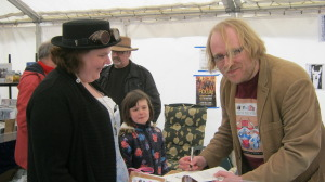 Stephen Morris signs a copy of his book for Elaine Woodhams